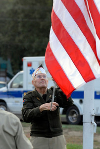 SPO, September 21 2007, Carl Sullenberger --- WW II veteran and VFW Post 6941 member Raymond Church begins his 51st year of raising the flag at Wellington football games on Friday, Sept. 21, 2007. He last raised the flag on Oct. 16, 2009, the final home game of the 2009 season.