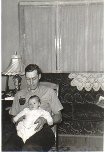 Ray Church holds his infant daughter, Janet, in the 1950s.