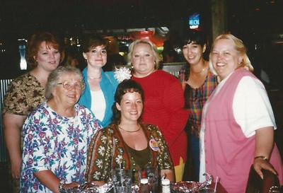 Sharon Borer, right, joins other family members in celebrating the birthday of her daughter, Tracy Wingate, front and center. (Photo courtesy of the family.)