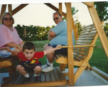 Sharon and Joe Borer swing with their grandson Jacob. (Photo courtesy of the family.)