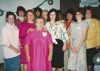 Sharon Borer, third from the left, with her mother, Margie Smith, in front of her at a family celebration. (Photo courtesy of the family.)