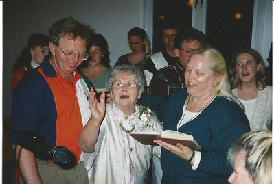 Sharon Borer, right, and her mother, Margie Smith, center, sing at church with other relatives. (Photo courtesy of the family.)