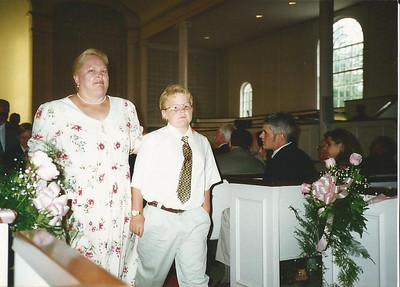 Sharon Borer is escorted by her grandson Joe at a church wedding. (Photo courtesy of the family.)