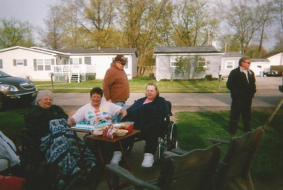 Margie Smith, Tracy Wingate and Sharon Borer hang out at another family doing in Margie's front yard. (Photo courtesy of the family.)