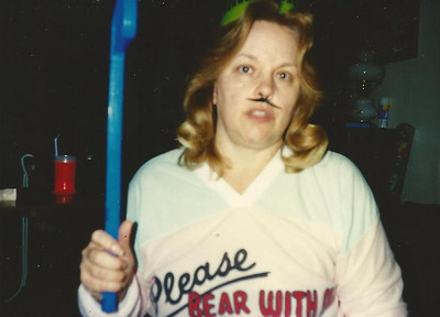 Sharon Borer being silly, acting like a hockey player on Halloween. (Photo courtesy of the family.)