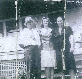 Sue Sklenar with her parents at their home in Elyria.