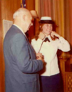 """Elyria Police Chief Maurice Flood, left, welcomes Teddy Zestoki as the first woman to hold patrolman status with the police force in July 1973. When a reporter asked her about potentially dangerous situations she might face, Teddy (later known as Teddy Witt) said """"I would pray a lot. I'll try to use common sense. You never really know how you're going to act in such a situation."""""""