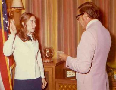 Teddy Zestoki is sworn in as a the Elyria Police Department's first woman patrolman by Mayor Leonard Reichlin on July 20, 1973.