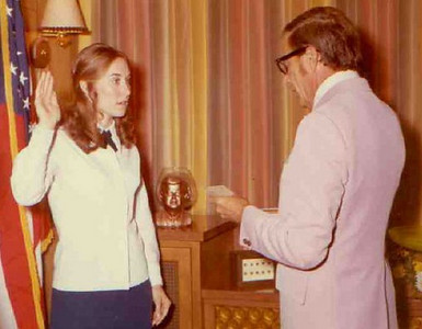 Teddy Zestoki is sworn in as a the Elyria Police Department's first woman patrolman by Mayor Leonard Reichlin on July 20, 1973.