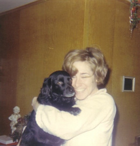 "The former Teddy Zestoki and one of her two black dogs at home in Lorain. ""She loved flowers, did gardening, loved to plant flowers,"" said her husband, Larry Witt. ""She loved every living thing. Animals, people. To her they were all the same."""