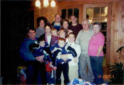 Teddy Witt, center, is surrounded by her immediate family in 2003. At the extreme right are her mother and stepfather, Joan and Joseph Trelay, who were married just a few months before Teddy and her husband, Larry.