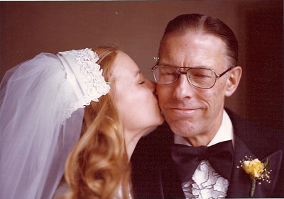 Tom Bowen gets a kiss from his daughter Tina at her wedding in September 1977.  It was the day before his 57th birthday. (Photo courtesy of the family.)