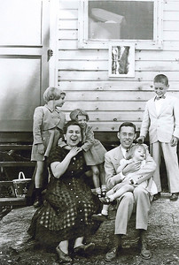 The Bowen family on vacation at Camp of the Woods, NY., around 1954. Pictured are daughters Charlotte, left, and Jeanette with her arms wrapped around Mom Jean's neck, Dad Tom, holding daughter Tina, and son, Tom, on the far right. (Photo courtesy of the family.)