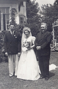 July 5, 1943: Bernie Schlather married Virginia Bilskey. On the right is the marrying priest, Rev. Joseph P. Walsh.