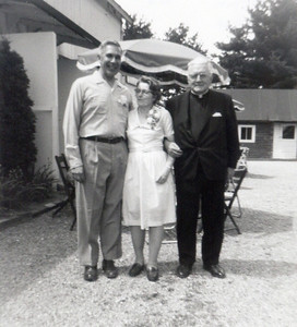The Rev. Joseph P. Walsh, right, who married Bernie and Virginia Schlather helped them celebrate their 25th wedding anniversary in 1968.