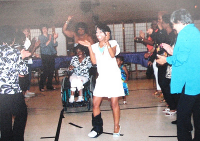 A black cast on her right leg could not prevent Tippie Moon from wearing a stylish high heel or dancing down the Soul Train line at her sister JoAnn's retirement party.