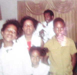Little Tippie Moon, front and center, sqeezed into this picture of relatives with her brother, Robert, right.