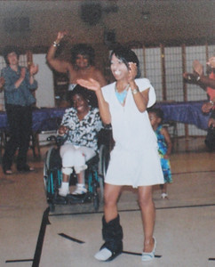 A black cast on her right leg could not prevent Tippie Moon from wearing a stylish high heel on her left foot or from dancing down the Soul Train line at her sister JoAnn's retirement party.