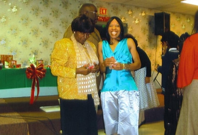 Martha Pye, left, and Tippie Moon, right, were winners at Second Baptist Church's annual Christmas party.
