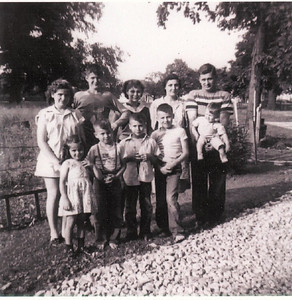 Kuns family portrait from late 1940s: Back row from the left are Joyce, Roger, Beverly, Ordean (mother) and Dale (father) holding Steve; First row from the left are Kate, Gary,Tom and Dick.