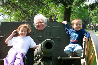 Tom Kuns hams it up at the cannon at Lakeview Park with his grandkids Allie and Michael.