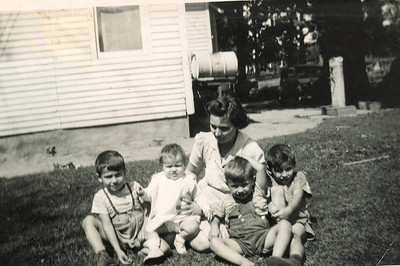 From the left, Tom Kuns, his sister Kate, mother Ordean and brothers Dick and Gary sat long enough to be photographed at Tom's grandfather's farm on Ohio Route 101 south of Clyde, Ohio, in the 1940s.