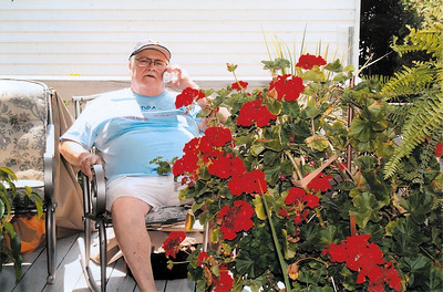 Tom Kuns coaxed this red geranium, pictured on his back porch, to bloom year round for approximately 15 years.