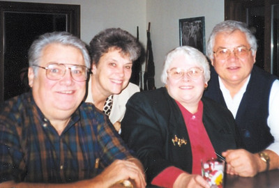 Tom Kuns, left, seated next to his wife, Peggy, often socialized with his brother Gary, right, and his wife, Mary, looking over Tom and Peggy's shoulders.