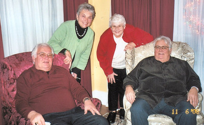 Tom Kuns, seated right, and his brother Gary, left, were close in age as well as close friends. Behind them are their wives, Mary and Peggy.