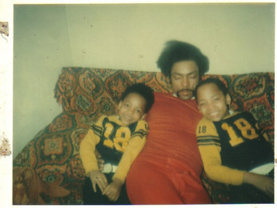 Tommie Jackson appears to be snoozing between sons Ereck and Jerome in the late 1970s.