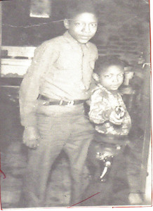 Young Tommie Jackson, right, with his older brother Sam in the 1950s.