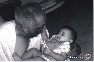 Tommie Jackson plays with one of his 17 grandchildren in 2006.He also has one great-grandchild.