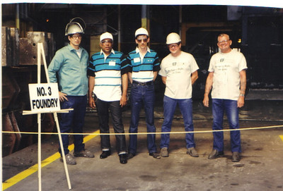 Tommie Jackson, second from the left, and co-workers pose at Elyria Foundry during an open house in the early 2000s.