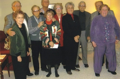 The Vargos, second couple from the right, played pinochle once a month with the other pictured couples since 1954. Eight couples belonged to the group at one time.