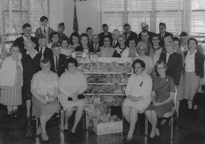 Velva Mihalis (seated on the far right), Tom Mihalis (second row, third from the left), and several other members of local veterans groups and ladies auxiliaries regularly visited and delivered treats to veterans who were hospitalized at what are now the Ohio Veterans Home in Sandusky and the Cleveland VA Medical Center in Brecksville.