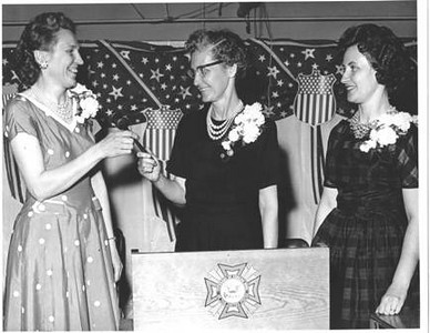 Velva Mihalis, center, presides at the VFW Post 1079 Auxiliary installation at which Gertrude Burns, left, mother-in-law of Velva's son John, was the incoming auxiliary president. Velva's daughter, Helen Resar, right, was the outgoing president.
