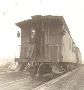 Warren Powelson surveys the area behind the freight train from the caboose.