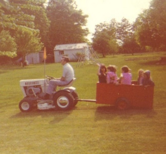 Warren Powelson pulls a wagon full of kids with his tractor.