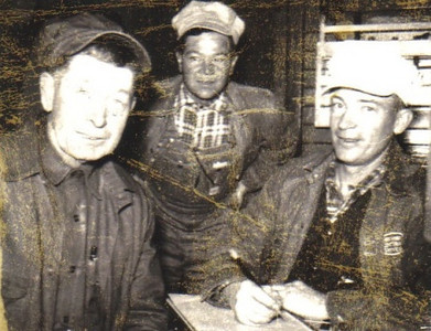 Warren Powelson, right, and a pair of fellow railroaders.