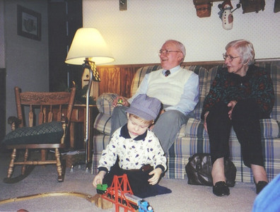 Warren and Margaret Powelson celebrate Christmas with great-grandson and model railroad enthusiast Joshua Drury in 1998.