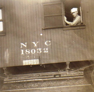 As a railroad conductor, Warren Powelson oversaw freight train operations from his office/living quarters in the caboose.