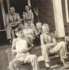 Warren and Margaret Powelson, on the porch with the kids.