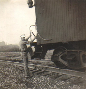 Warren Powelson climbs aboard the caboose of a train that hauled freight to and from Elyria and Youngstown.