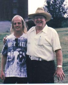 Larry Carroll has his arm around his eldest grandson, James Zagata, in 1995.