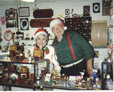 """Larry and Mary Anne Carroll, shown at their dollhouse miniatures stand at the East Oberlin Flea Market in the late 1980s, """"loved the Christmas season,"""" said their daughter Marge Zagata. """"My dad often played Santa Claus for my kids when they were young as well as other children over the years."""""""