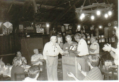 We have three photos of Larry Carroll that are in connection with his receiving the George Meany Award from Plumbers Local 55. The color pictures were taken in September 1998 at the union hall. It's unclear when or where the black-and-white photo were taken.  Please select the best-looking one. Here's the caption:  Plumbers Local 55 honored Larry Carroll with the George Meany Award for his outstanding contributions to the youth of his community through Boy Scouts of America.