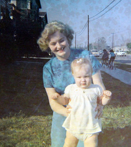 Marilyn Exline, pictured in 1961 when her name was Marilyn Hufford, shows off her daughter, Joy (now Joy Kidd), in Sun Valley, Calif.