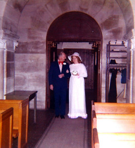 John Ayster prepares to walk his daughter, Marilyn, down the aisle to marry Jim Exline in 1974.