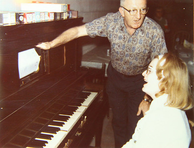 John Ayster of Gates Mills shows his daughter, Marilyn, the workings of a player piano.