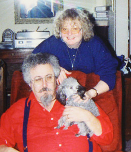 Marilyn Exline, standing, her husband, Jim, and their poodle, Tiny, at home.